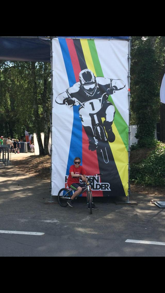 Lewis Posing By BMX Banner