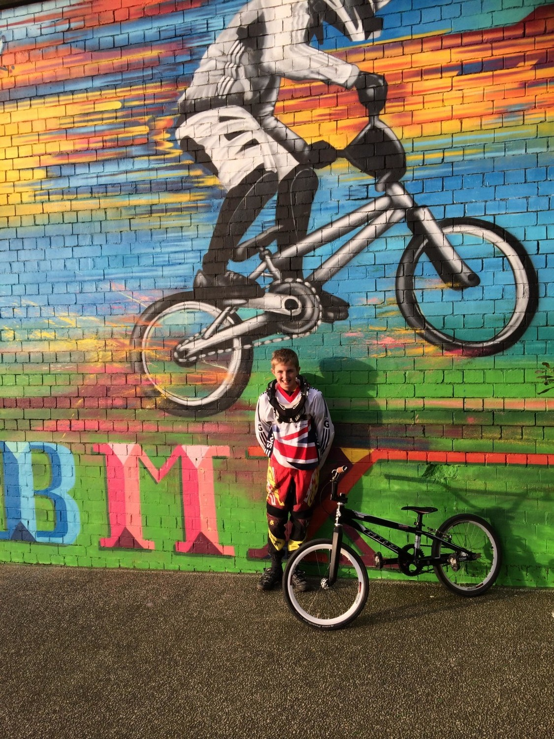 Lewis stood by BMX graffiti
